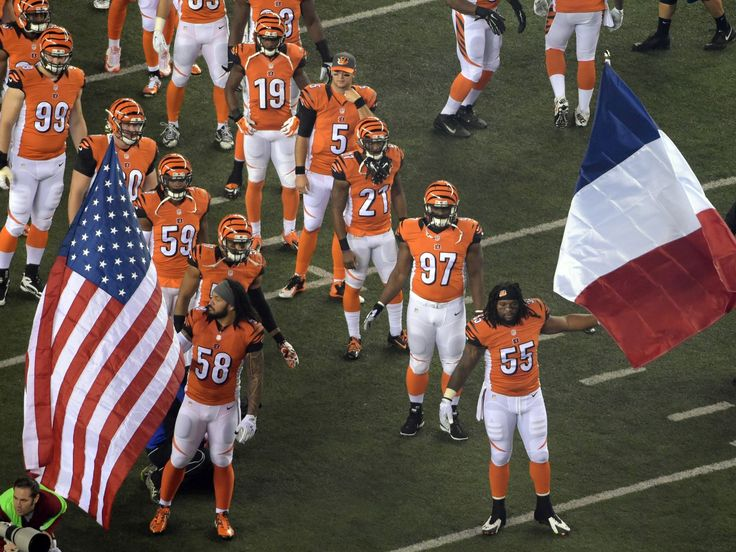 Cincinnati Bengals outside linebacker Vontaze Burfict (55) and middle linebacker Rey Maualuga (58) wave United States and French flags to honor Paris terrorist attack victims before the game against the Houston Texans in Cincinnati, Ohio. Kirby Lee, USA TODAY Sports