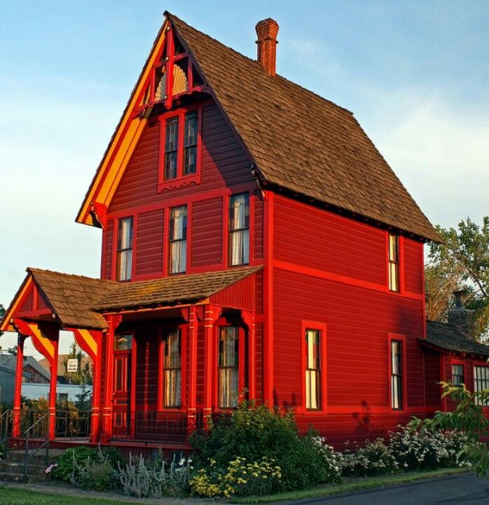 Old Red House built 1880's. This house was built in 1891 in Goldendale, Wa by Charles Newell, the largest individual horse dealer in the world. The headdress high on the front eaves was carved in tribute to his wife's Indian heritage.