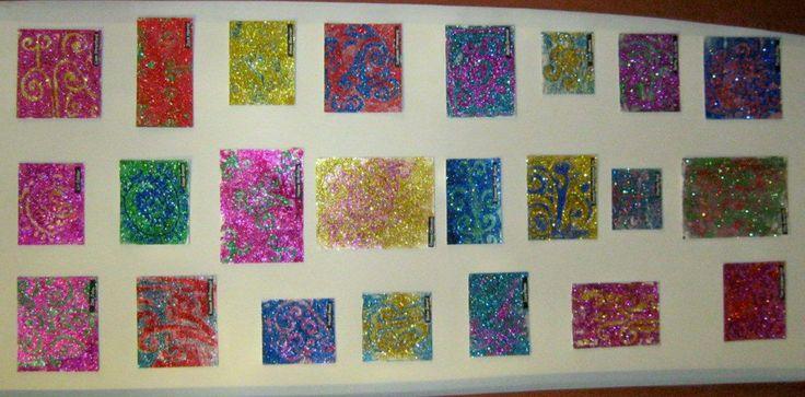 Making glitter koru patterns.