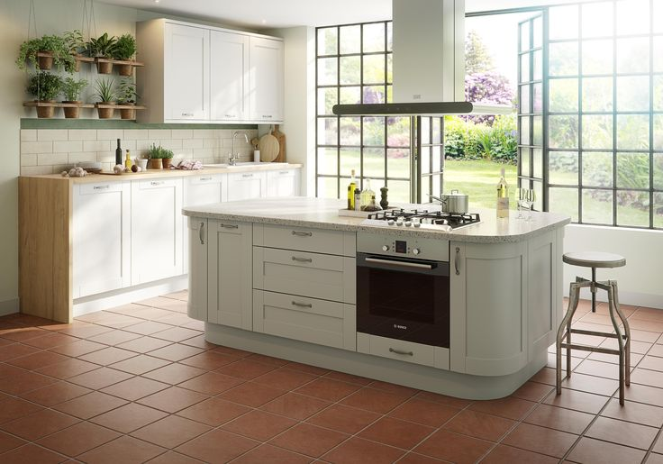 Worried your neutral kitchen will pale into insignificance? Don't be; combine with hardworking flooring such as terracotta tiles to add warmth and an injection of subtle colour.