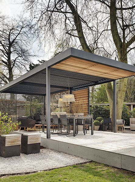 This contemporary pergola provides shade and shelter whilst appearing light and open. Photo credit: iqglassuk.com