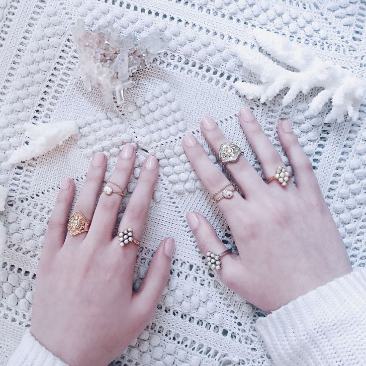 Learn how to stack your rings with this gorgeous assortment of fine stacking rings. Mix gold and silver, cocktail and fine chain rings, luminous pearls and white iridescent opals. Mix and match for a modern unique ring stack mix. Shop more beautiful finely crafted rings now via link
