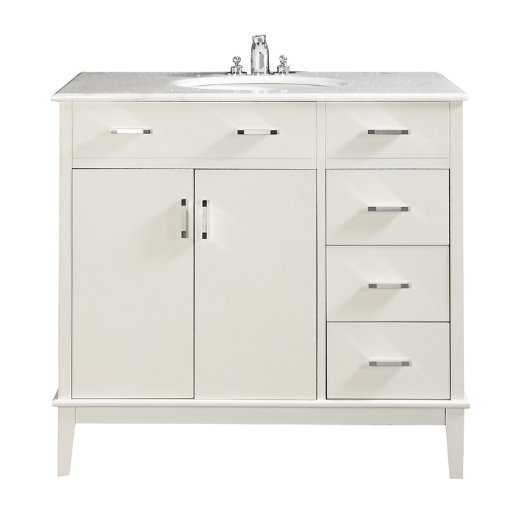 "$739.99 The Simpli Home Urban Loft 36"" Vanity is defined by its clean lines and contemporary look. This beautiful assembled vanity includes a marble top and an oval white vitreous china sink."
