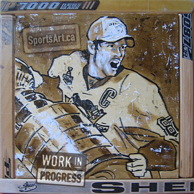 """""""The Kid and the Cup"""" - Sidney Crosby painting in progress, framed in hockey sticks."""
