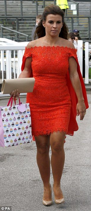Tan-tastic! Coleen Rooney appeared to have matched her Caribbean tan to her bright orange ...