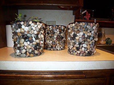 pebble flower pots. Cheap black planters + Liquid Nails + dollar store pebbles = cute.