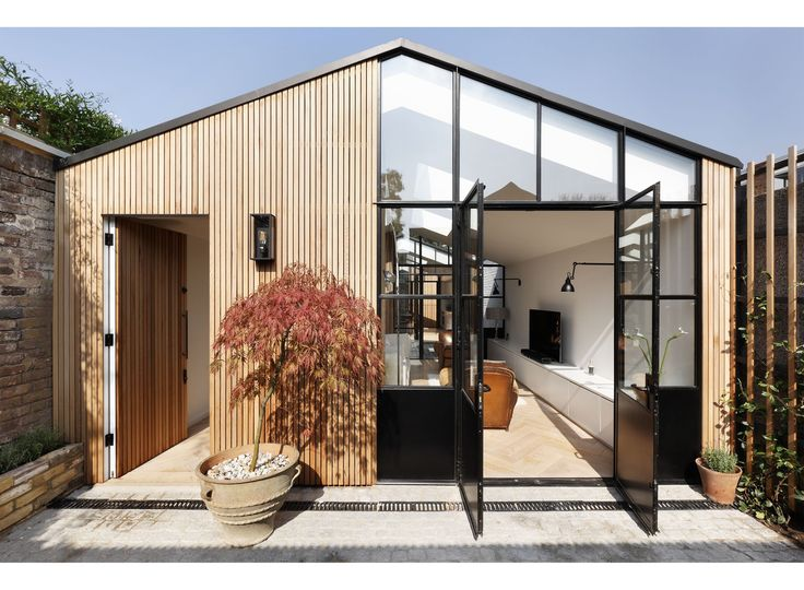 The Courtyard House is a minimal residence located in London, United Kingdom, designed by De Rosee Sa. De Rosee Sa have designed a house on the site of a former garage located in an awkward space between rear terraced gardens and a row of 16 west-London garages.
