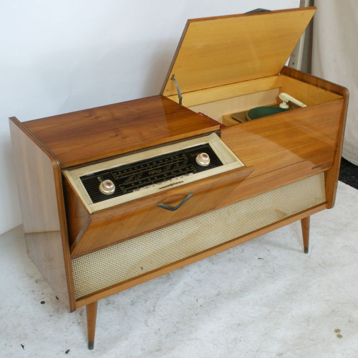 I own one of these old stereo's/record players. It belonged to my grandpa. Now it is hanging out in my hallway. LOVE it.