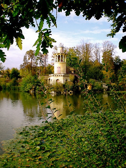 Marlborough Tower and the lake in the center of the Hameau on the grounds of the Petit Trianon, Versailles, France.