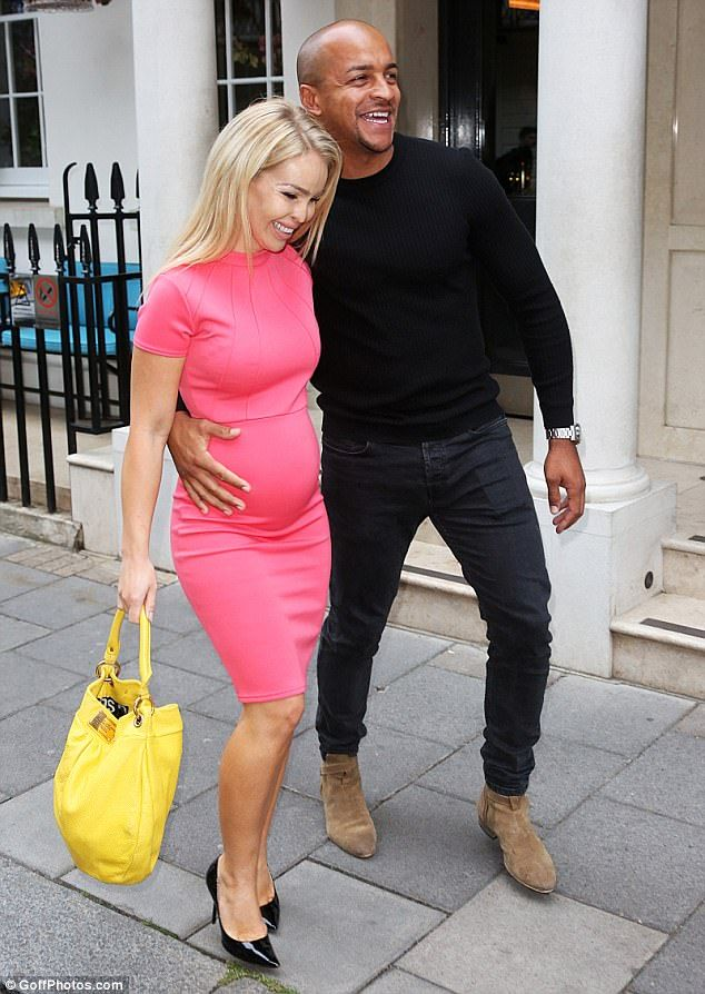 Giddy: Expectant parents Katie Piper and Richard Sutton were in particularly high spirits on Thursday, as they headed to abook launch party for Amber Green Takes Manhattan in London