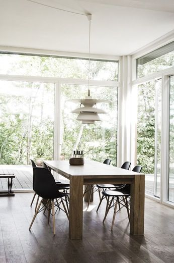 Kim Grenaa & Uffe Buchard summer cottage. Eames chairs and Louis Poulsen PH 5- 4 1/2