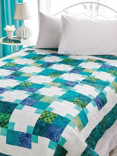 "You will be the victor with this lovely quilt.   Try a monochromatic color palette of blues to create a soothing day-at-the-beach quilt. Finished size is 63"" x 79""."