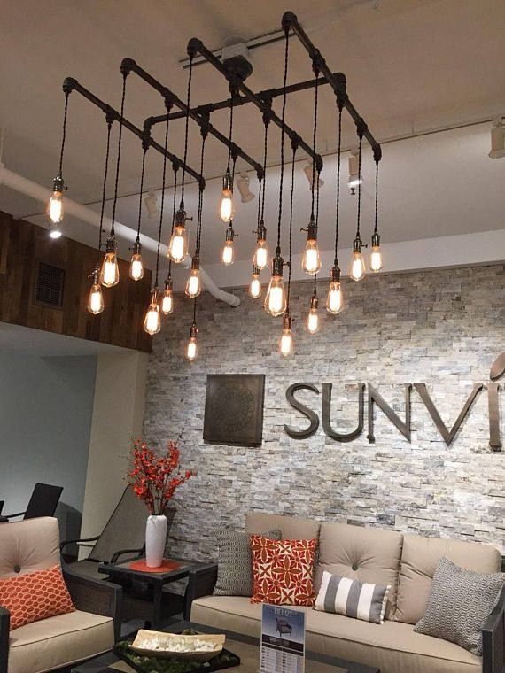 This gorgeous 16 or 20-light pendant chandelier is constructed from black steel pipe, iron fittings, and cloth-covered twisted lamp cord leading down to black nickel finished lamp sockets (see color chart for other socket colors), giving it that industrial turn of the century look.