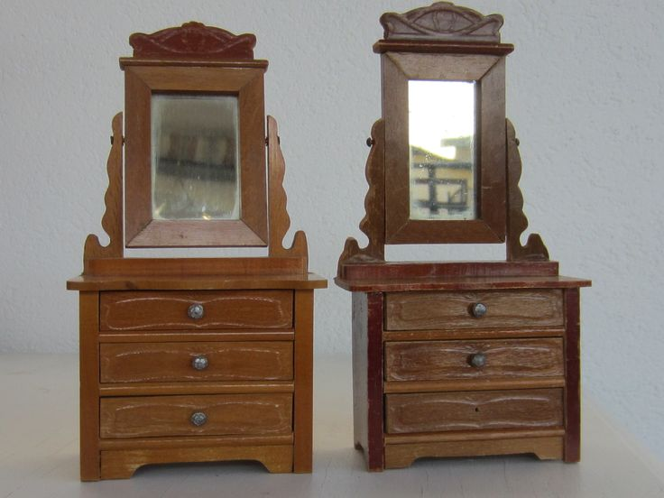 Two Schneegass dressers with three drawers and swivel mirror