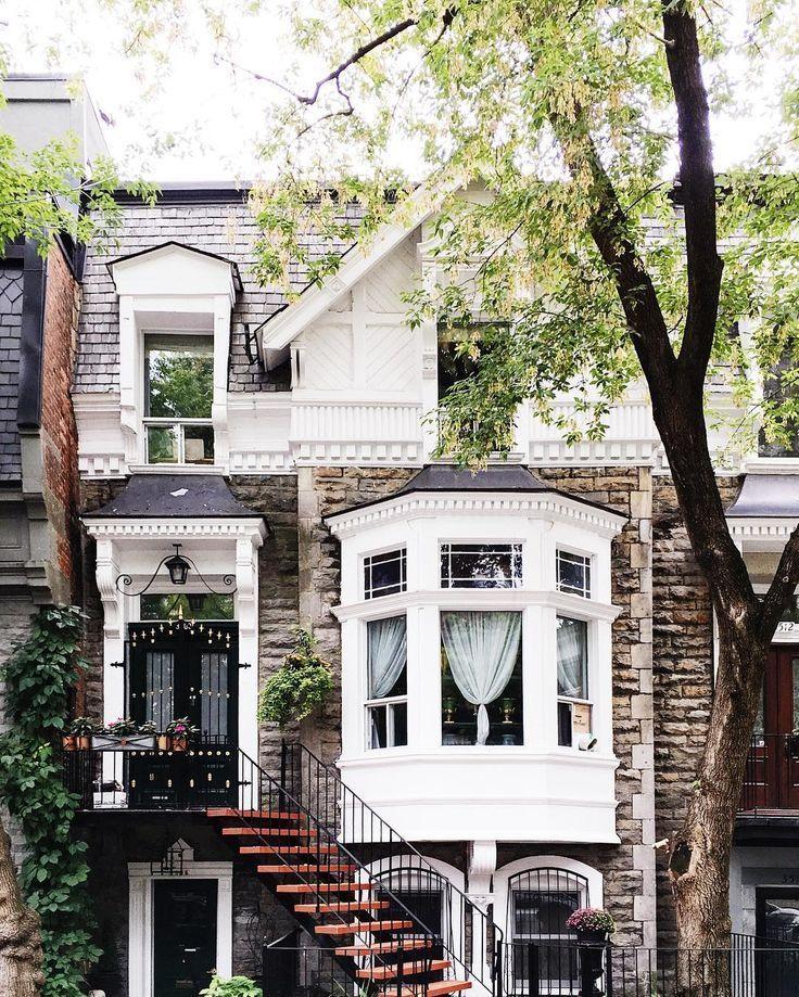 Three story townhouse with a big bay window, brick…