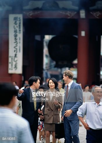 Stock Photo : Three business people in busy street