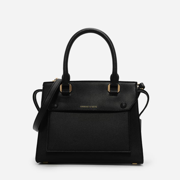 Black mid-sized structured handbag with top handles and zip closure. Pouch in front is detachable for a different look.