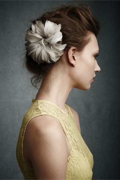Flower Accent Updo for Prom  http://www.beautyhigh.com/101-pinterest-prom-hairstyles/