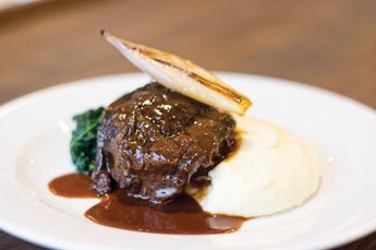 Paul Collins shares his recipe for slow braised beef cheeks, creamed potato, roast shallots and cavolo nero