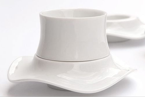 Dervish. Spaceship-like cups and plates. Stable and easy to hold.