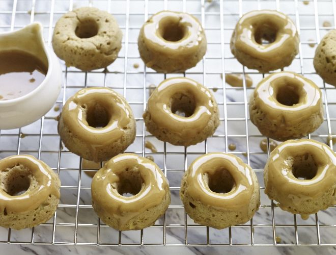 This doughnut recipe is baked with apple and cinnamon and glazed with apple cider. They smell delicious and taste better than any store bought brand.