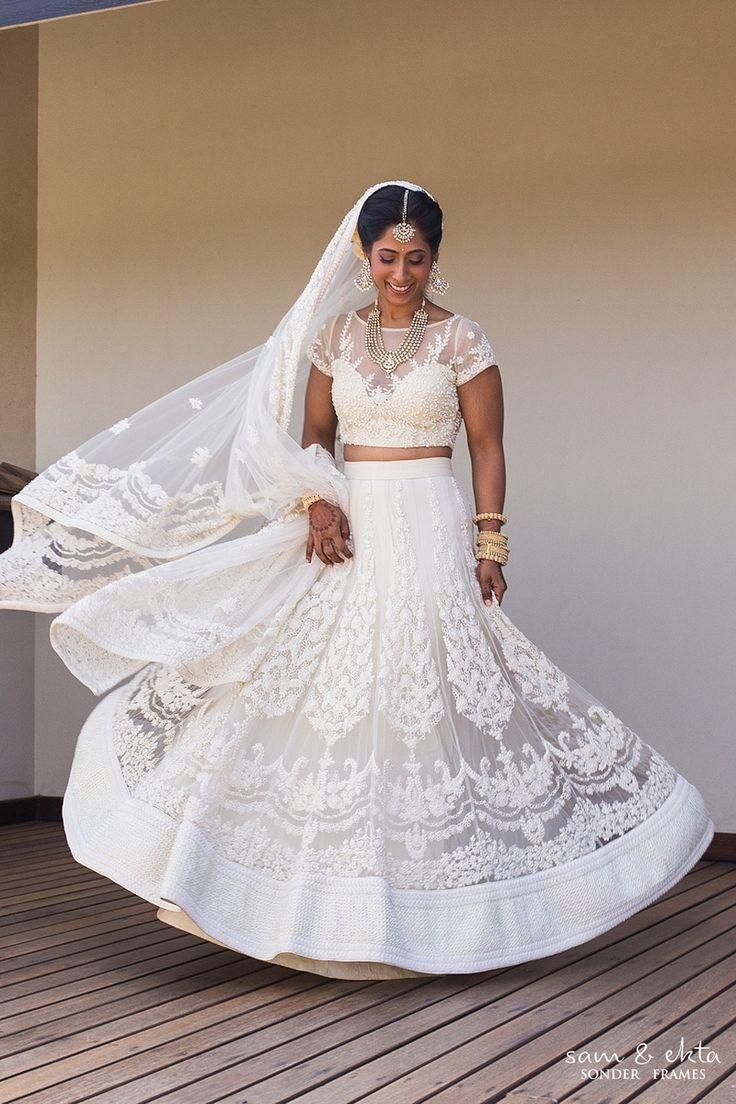White wedding lehenga styled with polki studded ma…