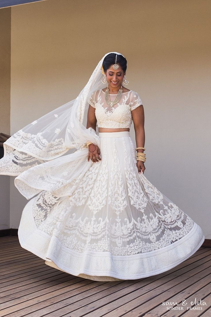 White wedding lehenga styled with polki studded maangtikka and elegant bridal makeup by Sunita from Styleby Sunita. | weddingz.in | India's Largest Wedding Company | Wedding Venues, Vendors and Inspiration | Indian Wedding Bridal Fashion White Lehenga |