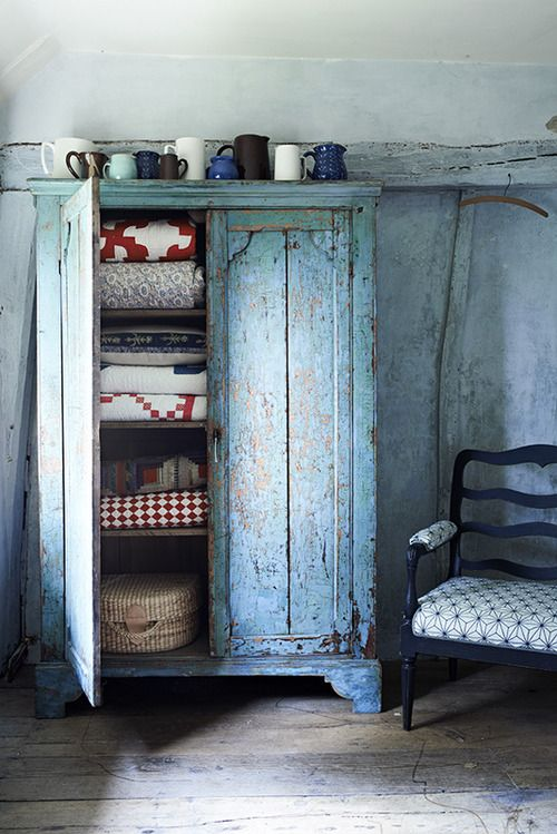Love The Blue Cupboard With The Quilts