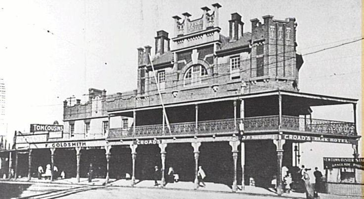 "Bank Hotel, Newtown, 324 King St, Newtown. ... c 1912 ... Photo taken from 1912 Newtown Jubilee Souvenir Booklet, (p. 183). Showing hotel loacated at Newtown Bridge and adjacent businesses incl. Goldsmith's & oyster stall. ""The busiest part of Newtown - where all the outward trams stop before diverging off to St Peters, Enmore and other places"" ... SRC8318 / City of Sydney Archives"