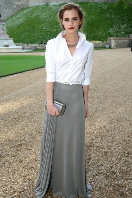 Emma Watson took a bit of a style risk at the Duke of Cambridge's charity dinner last night - and it paid off.  The 24-year-old Noah star chose a classic Ralph Lauren ensemble, wearing a timeless white shirt with a beautifully draped grey skirt and a skinny white belt. She wore her hair loosely pulled back and added carried a metallic Roger Vivier clutch.   The crisp-collared shirt and full skirt combination tends to be a more mature look look