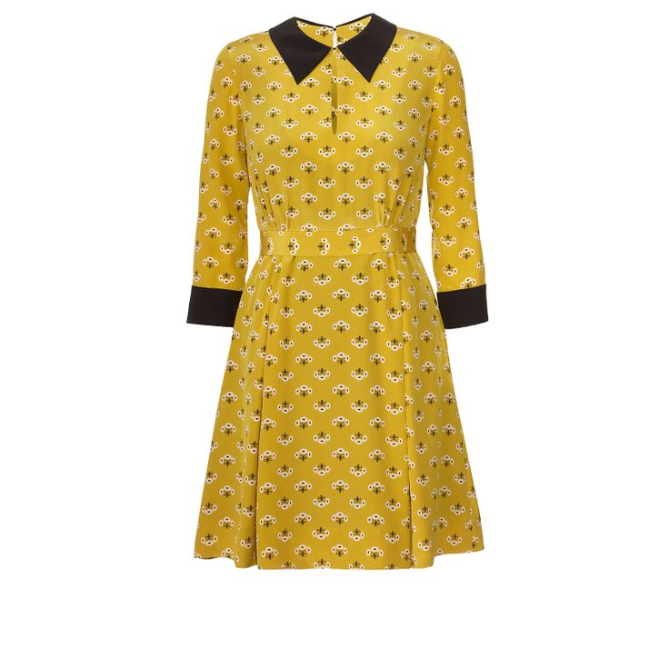 Orla Kiely: Silk crepe de chine dress in 'Posie Print' with 3/4 length sleeve and pointed collar. Collar and cuff  are in contrast solid black. The dress has simple slit at neck, gentle gathered skirt and waistband that turns into a bow tie at back waist. Fully lined. Zip in back to fasten.    Length: 84cm