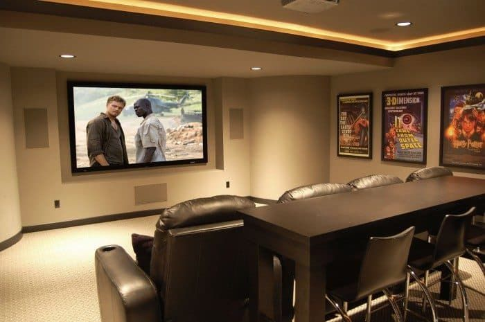 Home Theater With Wall Posters And LED Lighting