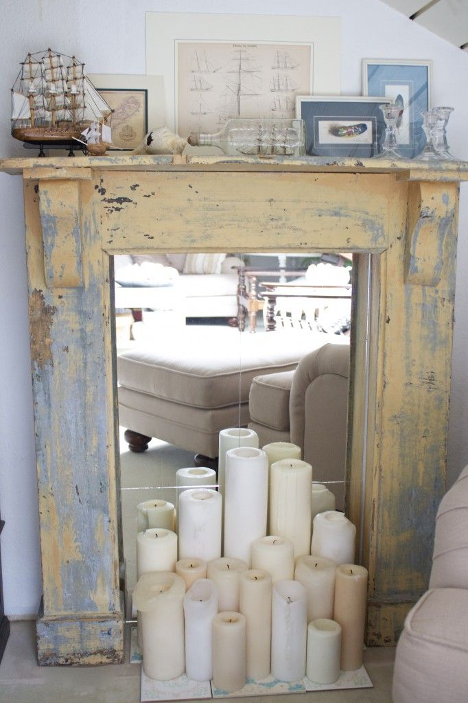 Faux Fireplace - I love the idea of candles in a fireplace when it's not being used otherwise, gives visual interest to the space and takes care of having an ugly gaping black hole in your living room