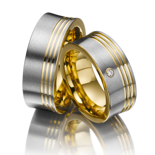 Wedding rings Eternal Touch - Gold plated stainless steel, Width: 9.00 - Height: 3.00 - Stones: 1 brilliant cut diamond 0,03 ct. tw, vs (Ring 1 with stone, Ring 2 without). All wedding rings can be configured according to your individual wishes.