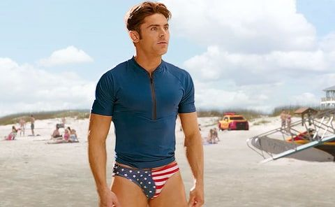 Zac Efron flaunts his hot body in a 'freedom' Speedo in a new 'Baywatch' preview, which aired during the Super Bowl — see the internet's best reactions to his skimpy swimwear