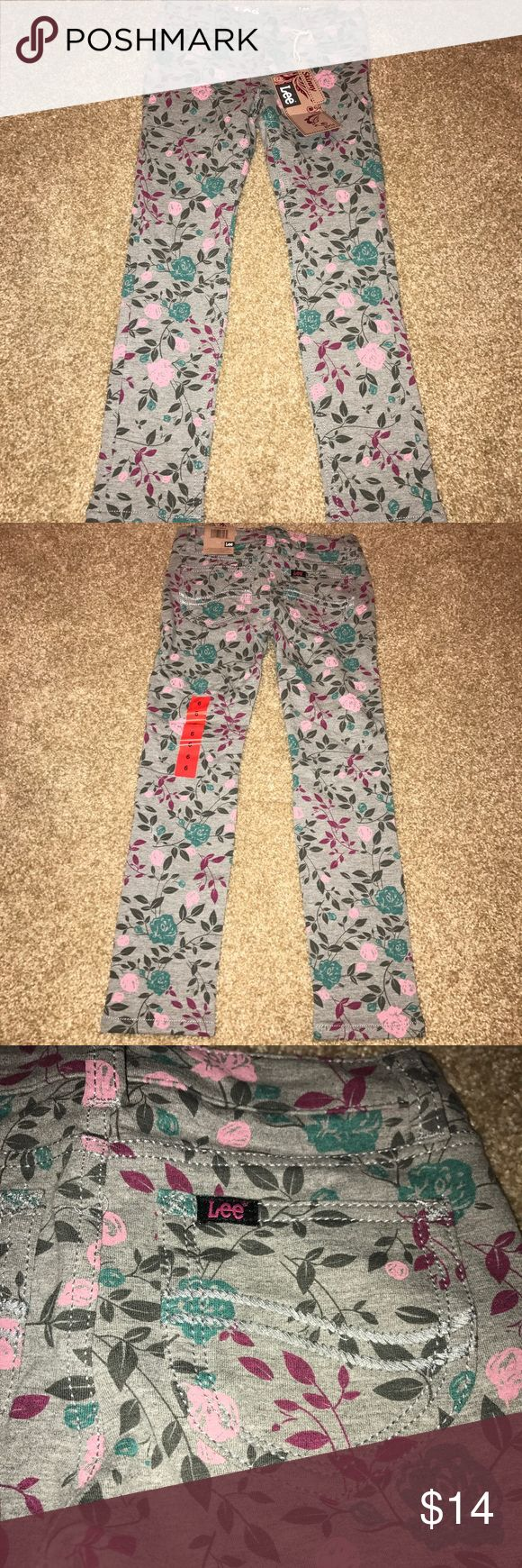 Lee Floral Skinny Stretch Jegging Pants Size 6 Lee Floral Skinny Super Stretch Jegging Pants Girls Size 6. Gray/Pink/Teal. Adjustable waist. 53% cotton 42% polyester 5% spandex. BRAND NEW WITH TAGS!! Lee Bottoms Jeans