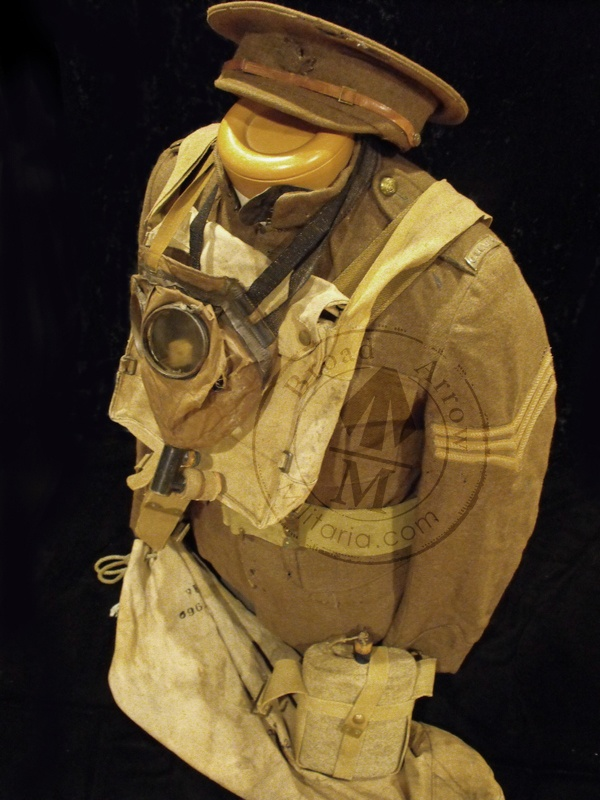 Tunic to the 75th Battalion with small haversack, P08 Belt, waterbottle, kit bag and a well worn example of Canada's first gas mask with proper bag behind.