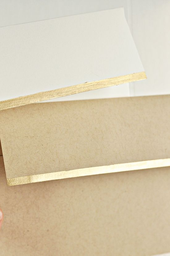 add a little somethin' extra to envelopes with a gold paint pen