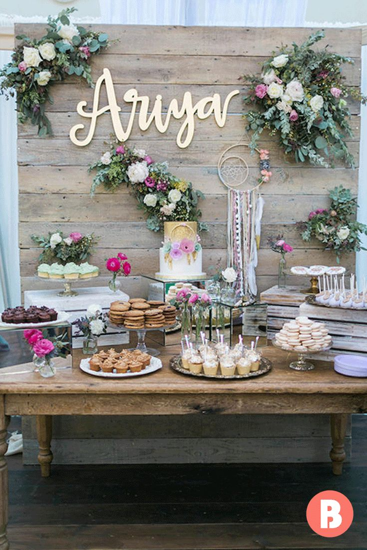 Just because this vintage-style display is fit for a flower princess doesn't mean it won't work if you're expecting a prince. PS: We're loving the name lettering on the wall — an intimate, personalized touch!