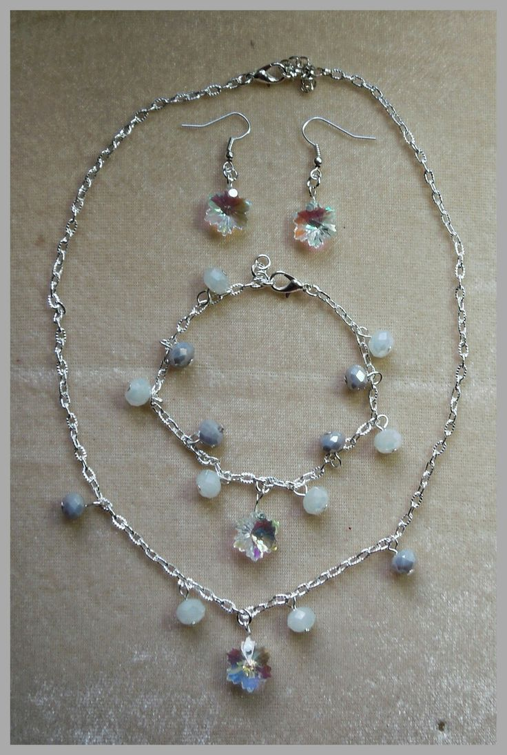 Winter seasonal faceted glass crystal beads & silver plated decorative chain...sparkles beautifully as its moved :-)