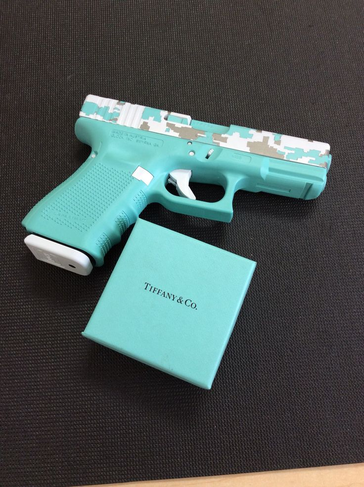 Glock. Tiffany's blue paint scheme. whatever gets her to the range