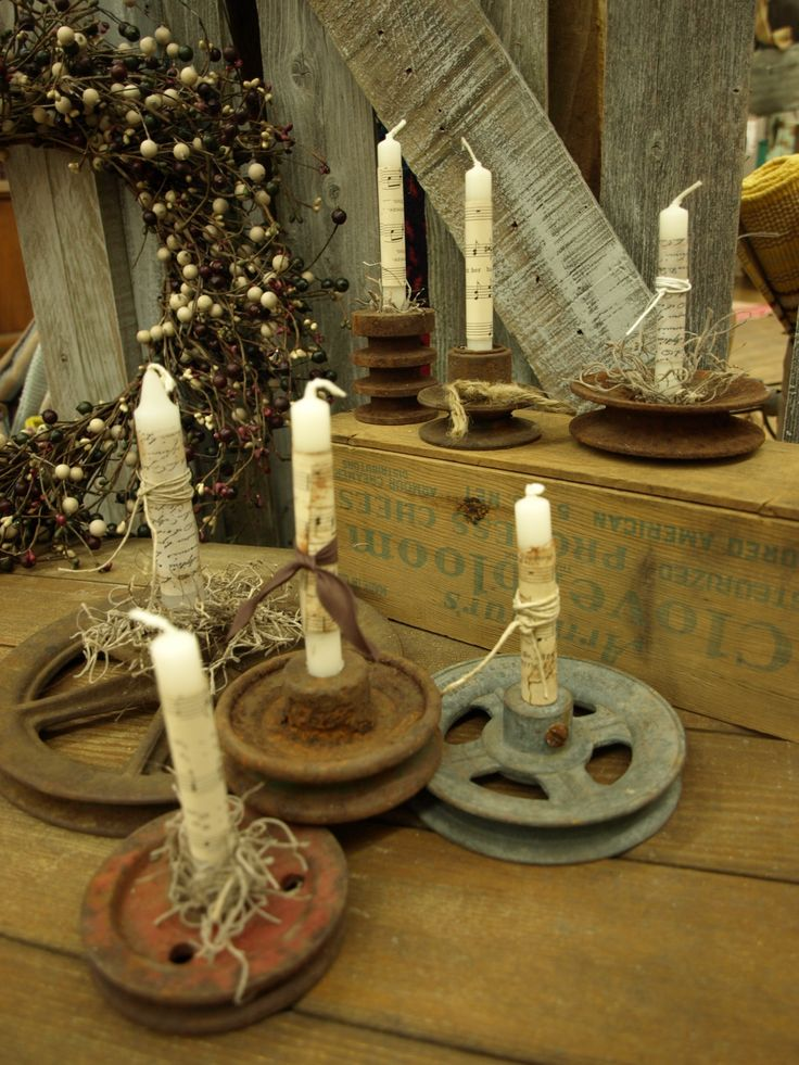 Tractor gears with vintage music sheet wrapped candles. Studio 184 Madison WI