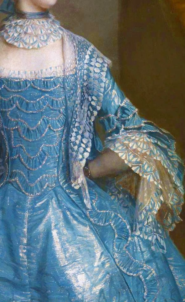 A sacque dress (à la Francaise) of turquoise blue and silver watered silk, with matching silk trimmings on the bodice. On her wrists two black silk bracelets mounted with miniatures. Detail from Suzanna Beckford, 1755, by Sir Joshua Reynolds. (c) TATE