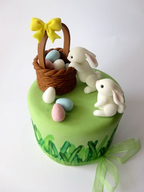 Bunny Cake Tutorial. With a great tutorial on making cute fondant bunnies. You could fill the basket with fondant carrots for a Birthday cake.