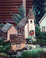 maison en carton et pommes de pins