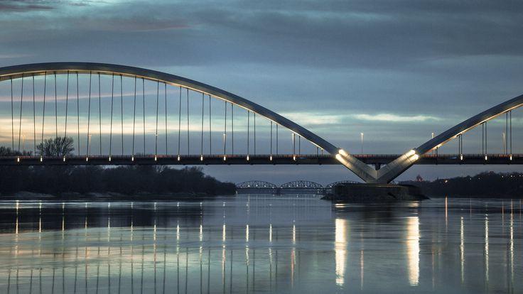 Toruń, Poland. Elżbieta Zawacka Bridge over the Vistula River in Toruń. (4 100 m, 540 m - main span). In the background Ernest Malinowski Railway Bridge (977 m) and behind Józef Piłsudski Bridge (898 m).