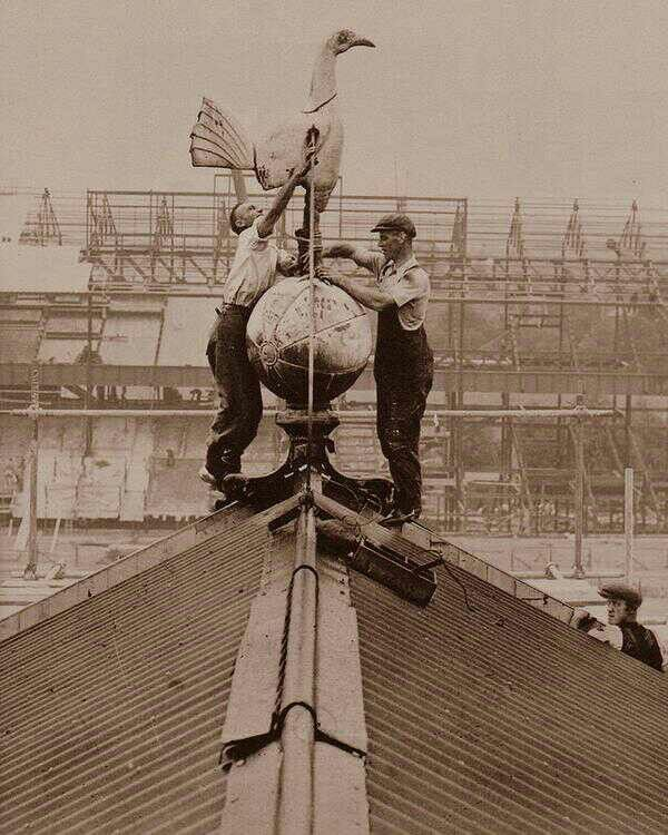 1934, Installation of the cockerel. East stand being built in background | Tottenham Hotspur Football Club