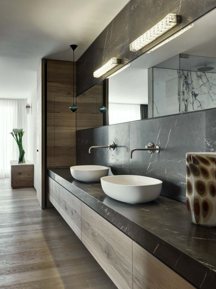 vessel sinks, countertop and backsplash slab, wall-mount faucets, floating vanities