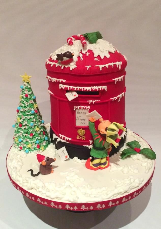 A little Elf trying to post his letter to Santa under the watch of a Mouse and Robin. Hope this cake is a hit with the family it is winging its way to….