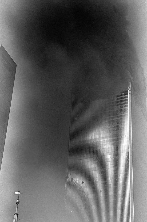 *9/11~I saw a lot of people jumping,I couldn't take pictures of that. I couldn't believe my eyes, that people had the strength, to die this way.To me it was the most powerful moment because a year before this I went on top of the WorldTradeCenter for the first time, I remember what I felt looking down, how high + scary it was.Seeing these people, I was picturing them looking down.You can see two silhouetts of people jumping from the building. I didn't know until I saw it on my…